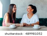 smiling mother and daughter in... | Shutterstock . vector #489981052