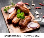 fried sausages with herbs on...