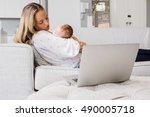 mother consoling her baby in... | Shutterstock . vector #490005718
