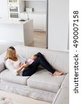 mother showing digital to her... | Shutterstock . vector #490007158