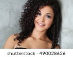 lovely woman with curly hair | Shutterstock . vector #490028626