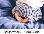 newborn photo. little feet...   Shutterstock . vector #490089586