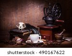Stock photo cup of coffee dry rose old books crow quills and coffee grinder on wooden table vintage still 490167622