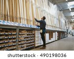 young handyman selecting a... | Shutterstock . vector #490198036