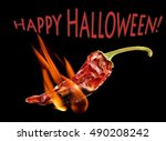 Small photo of Afire dry red hot chilli pepper, Happy Halloween