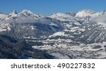 Small photo of Distant view of Saanen and snow covered mountains, Switzerland