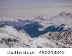 sunset in the winter alps. ski... | Shutterstock . vector #490243342