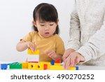 Cute Asian Girl Playing Blocks
