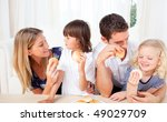 lively family eating burgers in ... | Shutterstock . vector #49029709