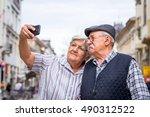 senior couple taking selfie... | Shutterstock . vector #490312522