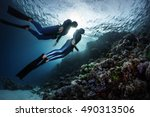 two freedivers swimming...   Shutterstock . vector #490313506