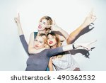 three female friends posing in... | Shutterstock . vector #490362532