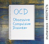 Small photo of OCD - Obsessive Compulsive Disorder written in notebook