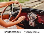 Female hands on classic car steering wheel and shift - stock photo