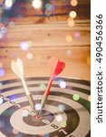 Small photo of Dart arrow hitting in the target center of dartboard. - Business accuracy concept