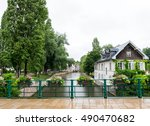river and houses in petite... | Shutterstock . vector #490470682