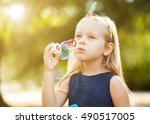 children girl blowing soap... | Shutterstock . vector #490517005