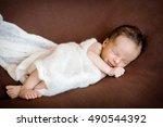 newborn boy is sleeping in the... | Shutterstock . vector #490544392