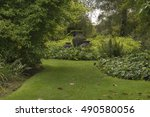 Slate Urns In The Shrubs At...
