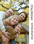 family relax in autumn park | Shutterstock . vector #490587922