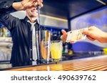 bartender taking money from the ... | Shutterstock . vector #490639762