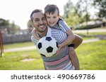 a man with child playing... | Shutterstock . vector #490669786