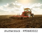 farmer in tractor preparing... | Shutterstock . vector #490683322