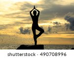 yoga and sillhoutte on the beach | Shutterstock . vector #490708996