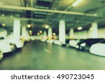 blur parking lot in shopping... | Shutterstock . vector #490723045
