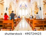 Blurred Christian Mass Praying...