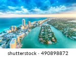 Miami Beach, wonderful aerial view of buildings, river and vegetation.
