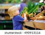 cute toddler boy in a food...   Shutterstock . vector #490913116