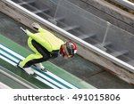 Small photo of Ski jump. Artificial track. Winter sport. Norwegian summer. Horizontal
