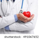 male doctor holding red heart... | Shutterstock . vector #491067652