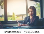 businesswoman working at office | Shutterstock . vector #491130556
