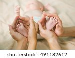 small feet of newborn toddler... | Shutterstock . vector #491182612