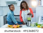 woman and daughter using mixer... | Shutterstock . vector #491368072