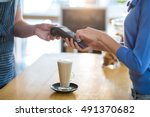 mid section of customer making... | Shutterstock . vector #491370682