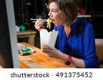 businesswoman eating noodles at ... | Shutterstock . vector #491375452