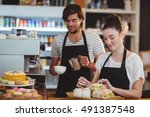 waiter and waitress working... | Shutterstock . vector #491387548