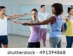yoga instructor helping student ... | Shutterstock . vector #491394868