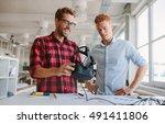 shot of happy young men testing ... | Shutterstock . vector #491411806