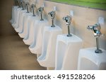 Row Of Outdoor Urinals Men...