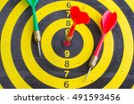 Small photo of Success hitting target aim goal achievement. Green Dart in bull's eye. Retro darts aim