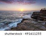 Small photo of Sunrise from Amble on the north east coast of England, looking towards Coquet Island. Amble, Northumberland, England, UK.