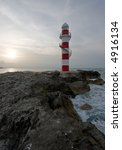 lighthouse in the tropics on a... | Shutterstock . vector #4916134
