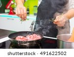 man cooking at home | Shutterstock . vector #491622502