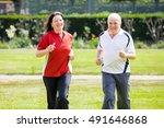 smiling senior couple running...   Shutterstock . vector #491646868
