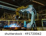 robot welding in car factory  | Shutterstock . vector #491720062