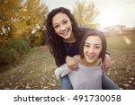 hispanic teenage girls having... | Shutterstock . vector #491730058
